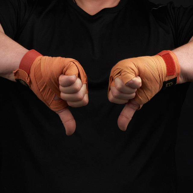 """athlete in black uniform and hands rewound with textile orange b"" stock image"