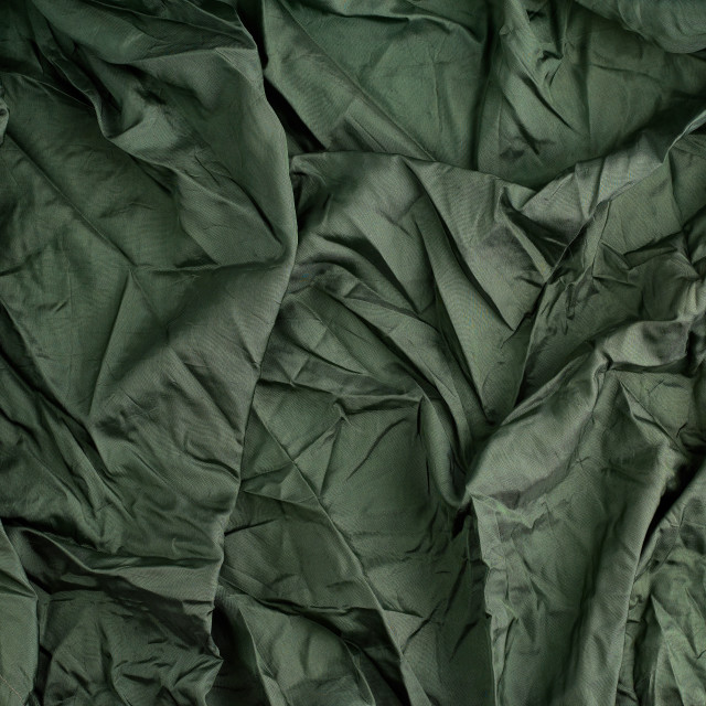 """""""green satin textile fabric, piece of fabric for sewing curtains"""" stock image"""