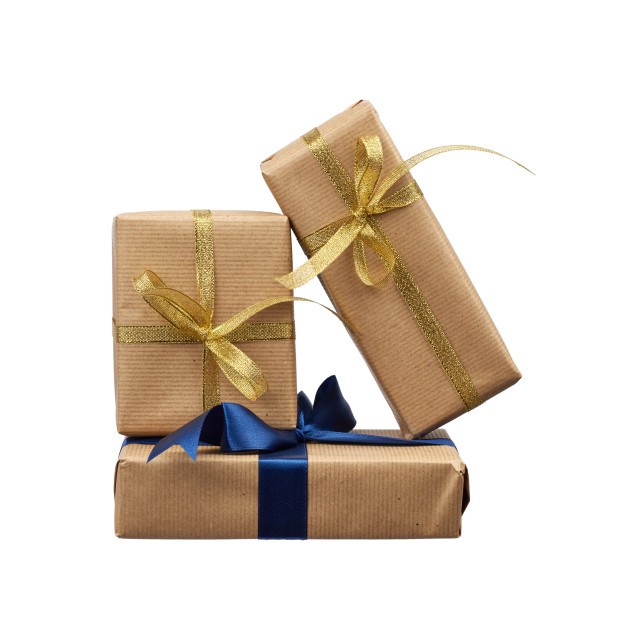 """""""stack of gifts wrapped in brown kraft paper and tied with a silk"""" stock image"""