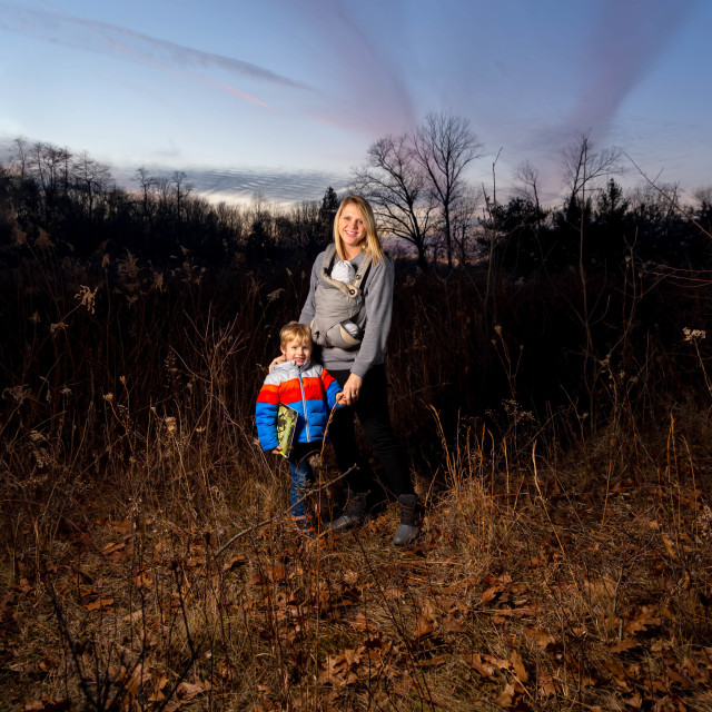 """""""Single Caucasian Mom Hikes With Her Newborn Child Attached to hi"""" stock image"""