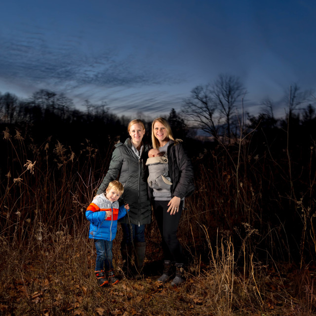 """""""Two Caucasian Mothers Hike With Their Children On A Moody Fall D"""" stock image"""