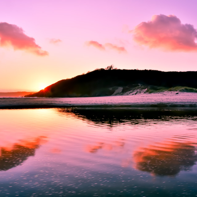 """""""Sunset at Three Cliffs Bay, The Gower Peninsula, South Wales, U."""" stock image"""
