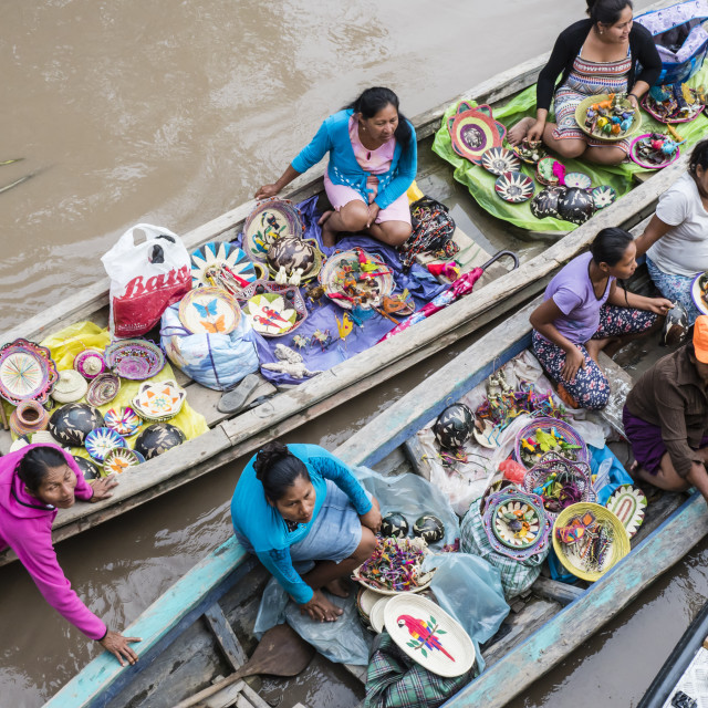 """""""Local craftswomen selling their wares by canoe on Pacalpa Caño, Pacaya..."""" stock image"""