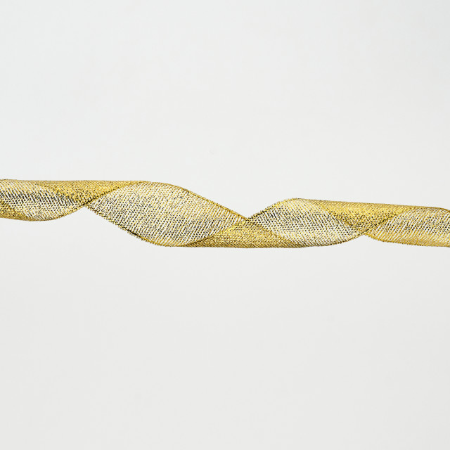 """""""twisted golden silk decorative ribbon for packing gifts"""" stock image"""