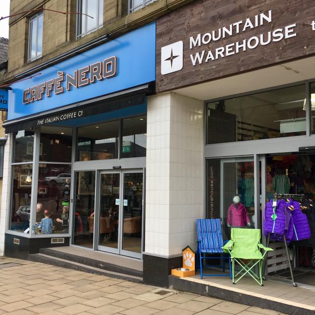 """Cafe nero and mountain warehouse shops in Ilkley, Yorkshire, UK"" stock image"