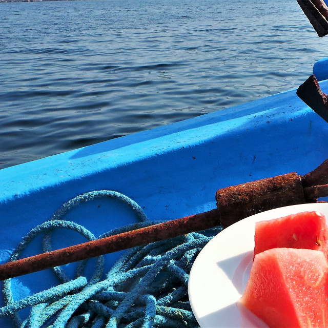 """""""Watermelon and rusty anchor on blue boat in Khasab Oman"""" stock image"""