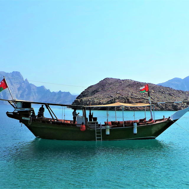 """""""Traditional wooden dhow boat in blue sea, khasab, Oman"""" stock image"""