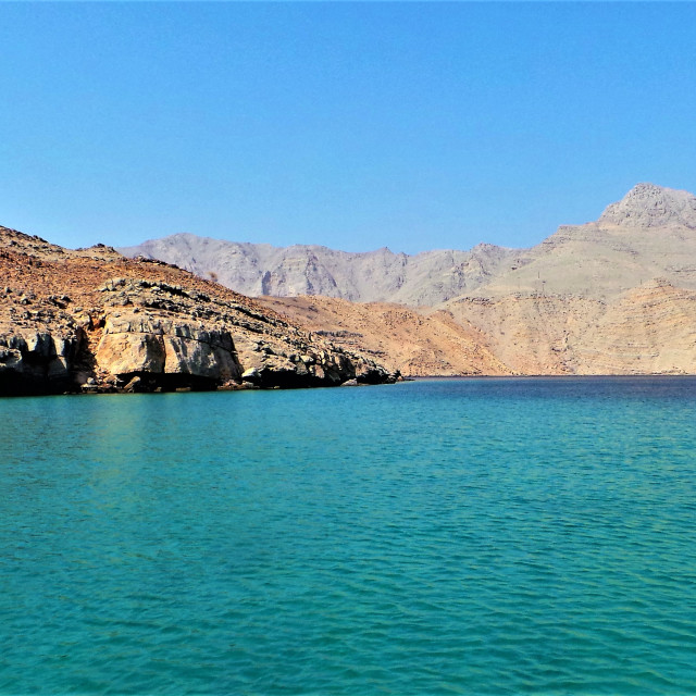 """""""Beautiful blue sea with rocky mountains in Khasab, Oman"""" stock image"""