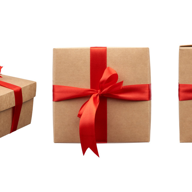 """""""square box wrapped in brown kraft paper and tied with a silk red"""" stock image"""