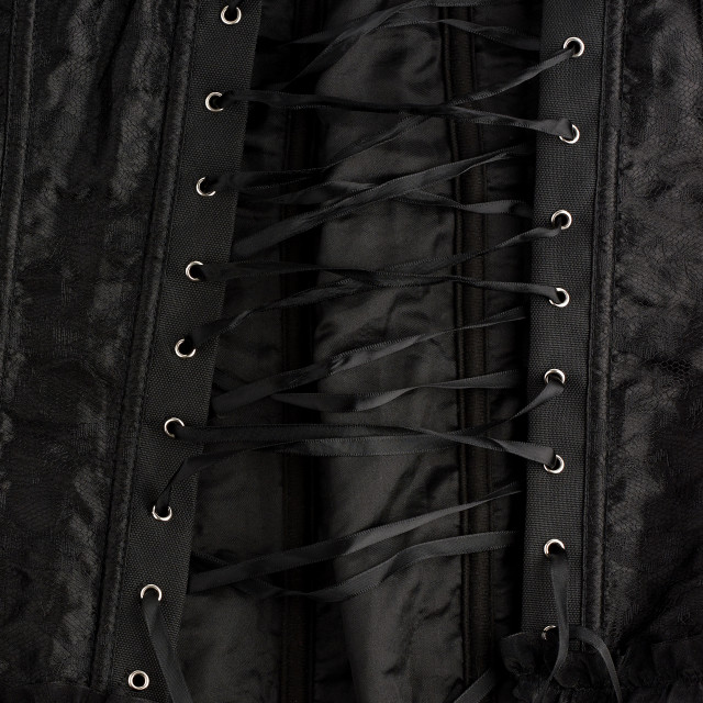 """""""fragment of a black satin corset with lacing, back view"""" stock image"""