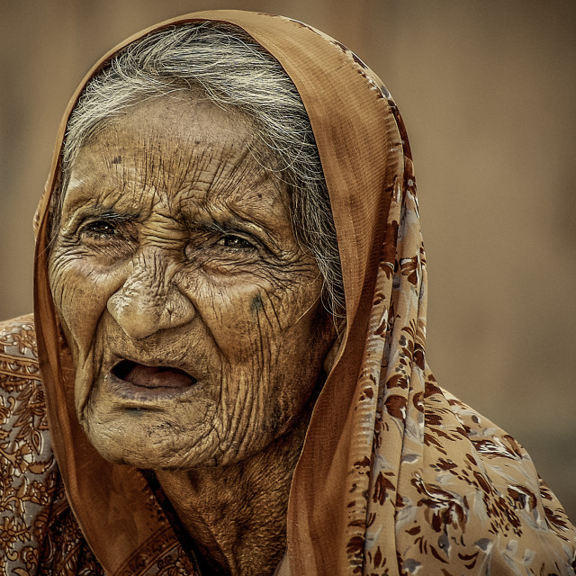 """old wrinkled Indian women"" stock image"