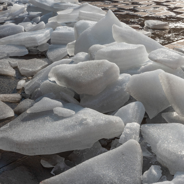 """""""Ice melts on the ground under the warm morning sun"""" stock image"""