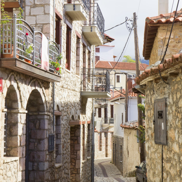 """Picturesque cobbled street in Arachova in Greece"" stock image"