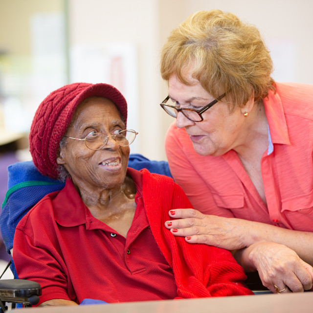 """""""Older Woman Together in a Busy Senior Center"""" stock image"""