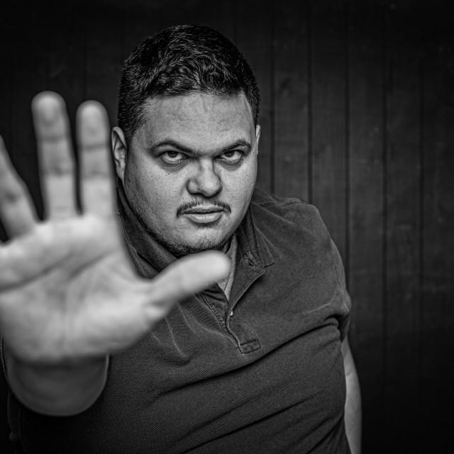 """Black and White Latino Man Gesturing Stop"" stock image"