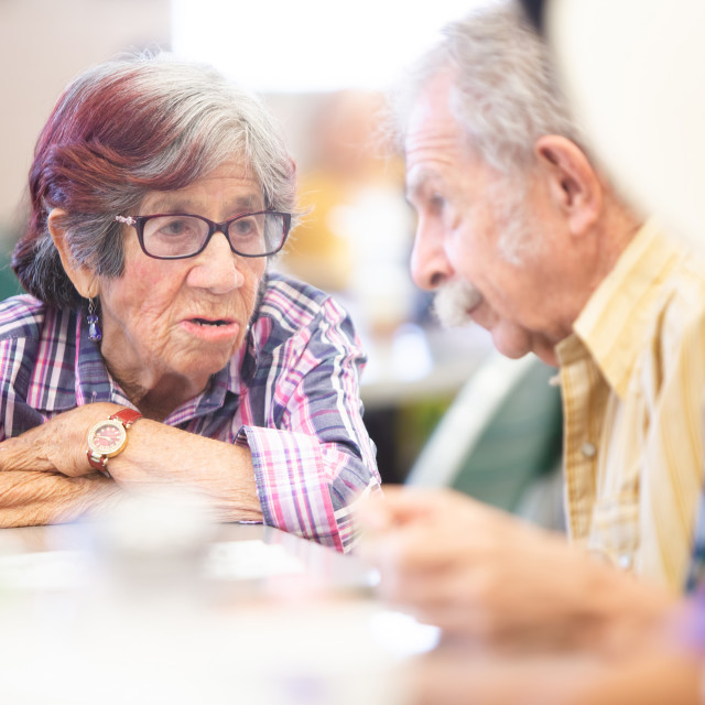 """""""Friends Talking in a Senior Center"""" stock image"""