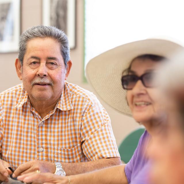 """Smiling Hispanic Man in a Senior Activity Center"" stock image"