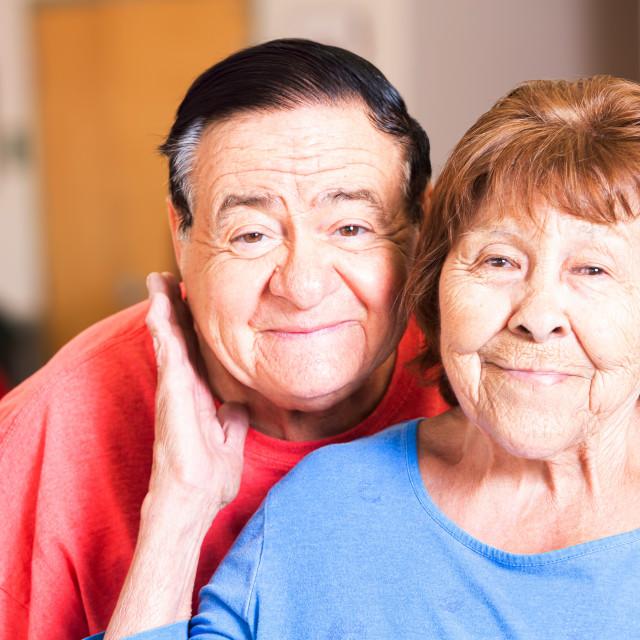 """Smiling Hispanic Couple in a Senior Center"" stock image"