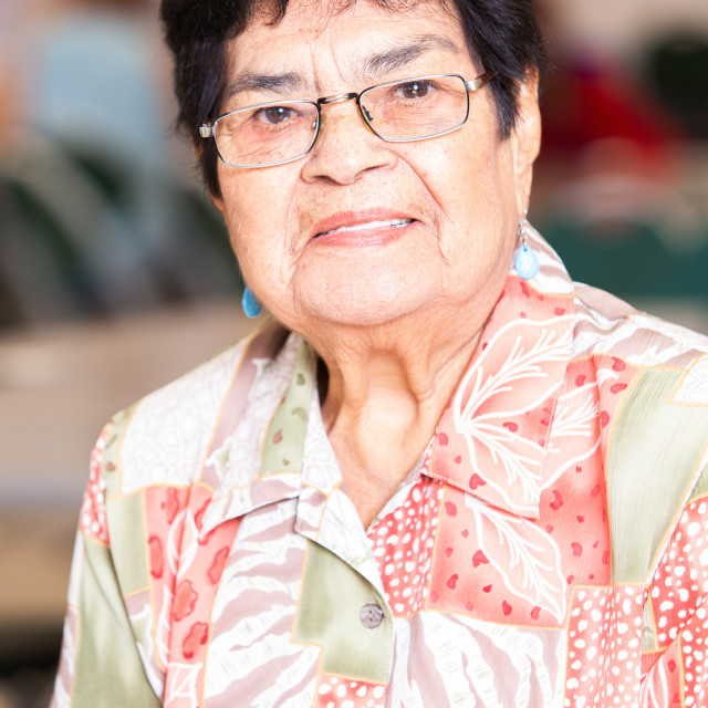 """Smiling Hispanic Woman in a Senior Center"" stock image"