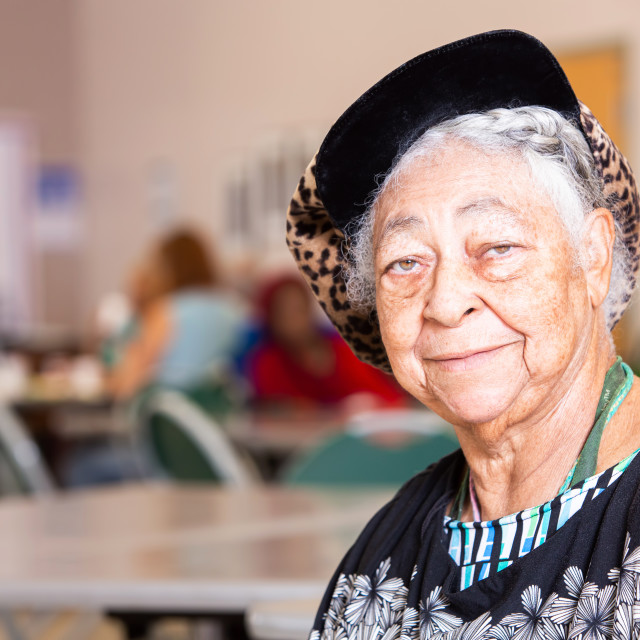 """""""Horizontal Shot of Smiling African American Woman in a Senior Center"""" stock image"""