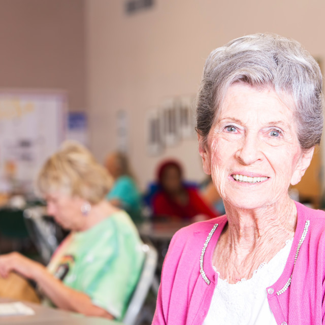 """Horizontal Shot of Smiling Woman in a Senior Center"" stock image"
