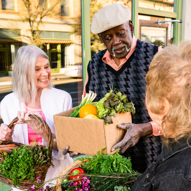 """""""Vertical Shot of Seniors Returning with Produce from Farmers Market"""" stock image"""