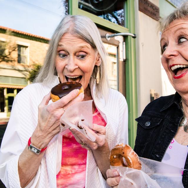 """Senior Women Eating Donuts"" stock image"