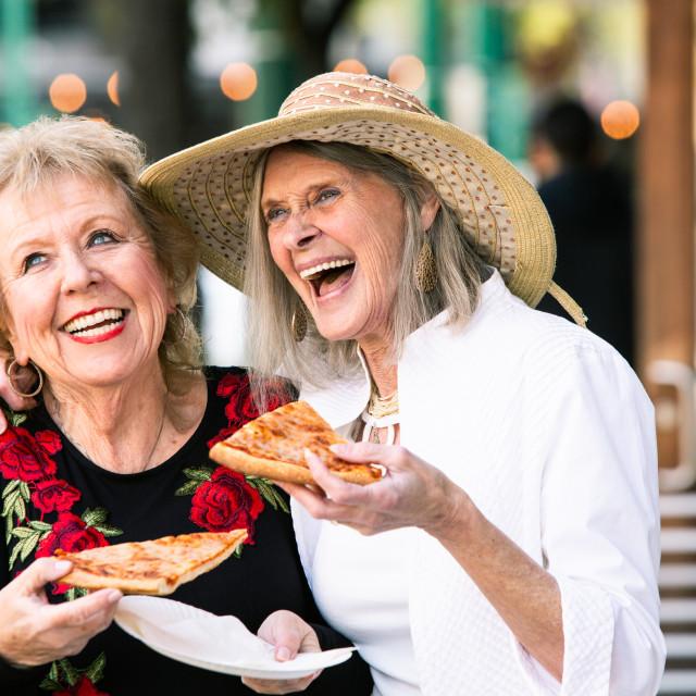 """Senior Women Eating Street Food and Laughing"" stock image"