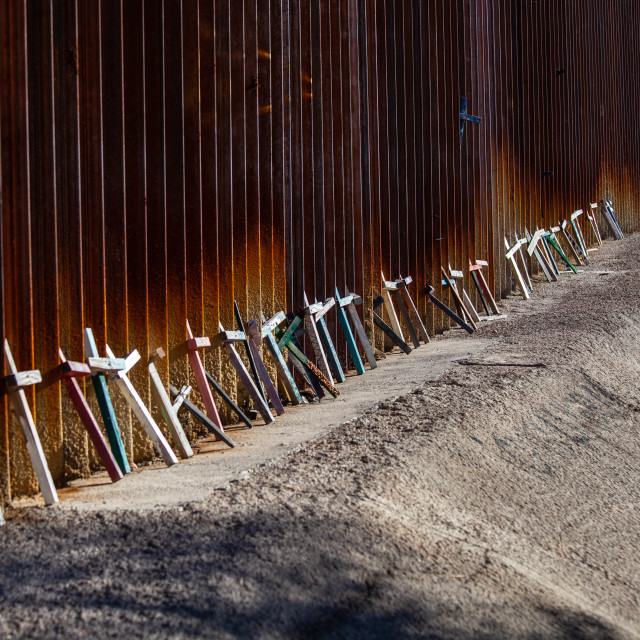 """""""Memorial Crosses Leaning Against United States Border wall with Mexico"""" stock image"""