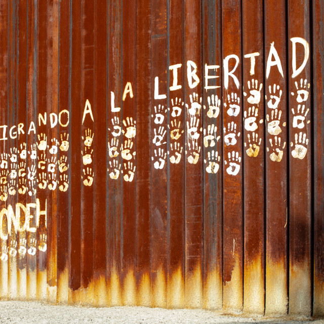 """""""Migrating to Freedom Painted on Mexican Side of the United States Border Wall"""" stock image"""