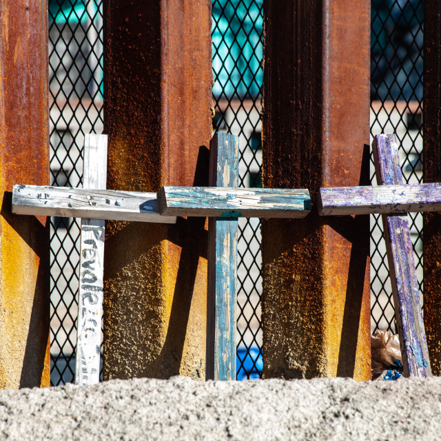 """""""Memorial Crosses Leaning Against Border Wall with Mexico Seeing Through to..."""" stock image"""