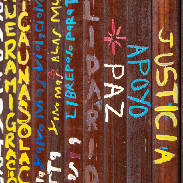 """""""Spanish Words for Peace Support and Justice on Mexican Side of United States..."""" stock image"""