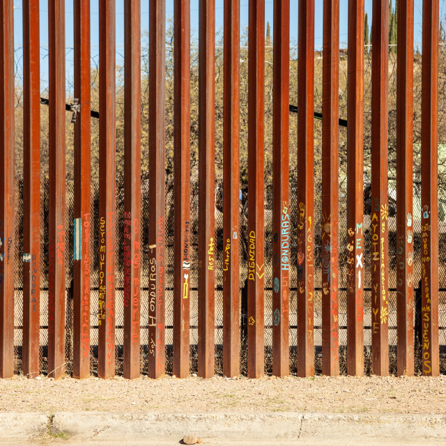 """""""United States Border Wall with Slogans and Art from Nogales Sonora Mexico"""" stock image"""