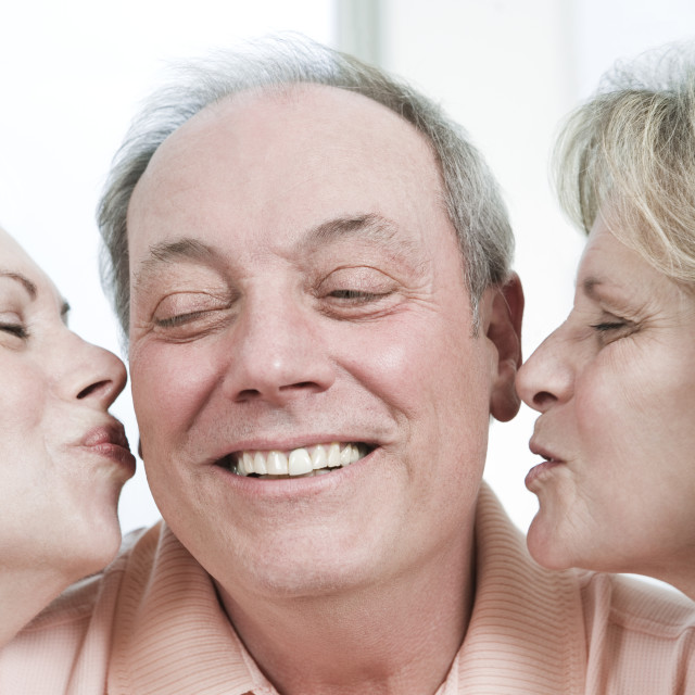 """""""View of mature women kissing a mature man."""" stock image"""