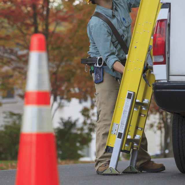 """""""Tradesman with a ladder and work truck"""" stock image"""