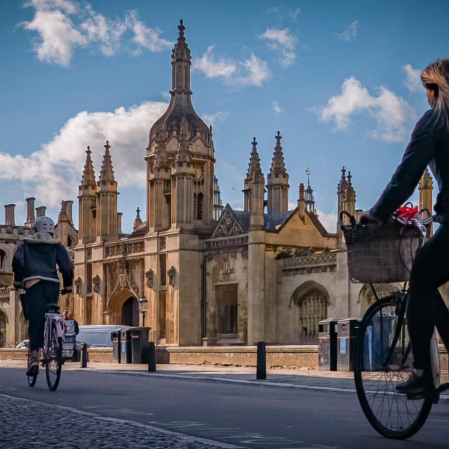 """Cyclists on Kings Parade Cambridge UK."" stock image"