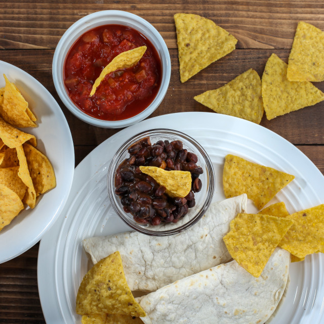 """""""Tortilla chips inside bowl with salsa , bacon and tortilla on ru"""" stock image"""