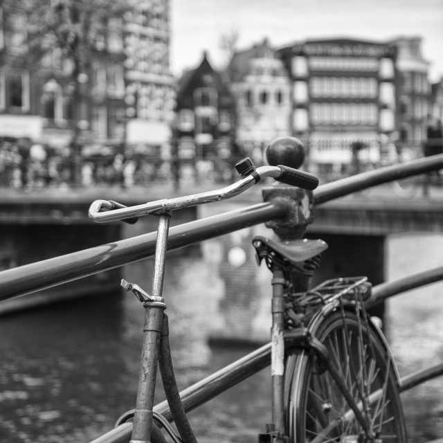"""""""An old bicycle on Amsterdam canal bank"""" stock image"""