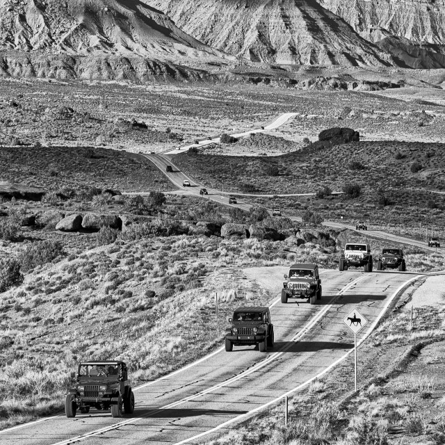 """Jeeps during Jeep Week on a desert highway in the landscape of Professor Valley, Utah, USA"" stock image"