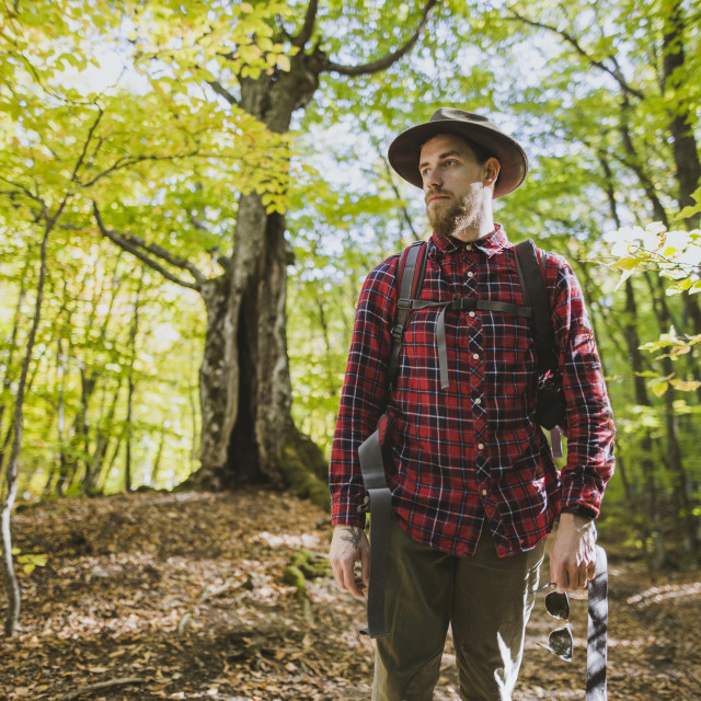 """Man wearing red shirt in forest"" stock image"