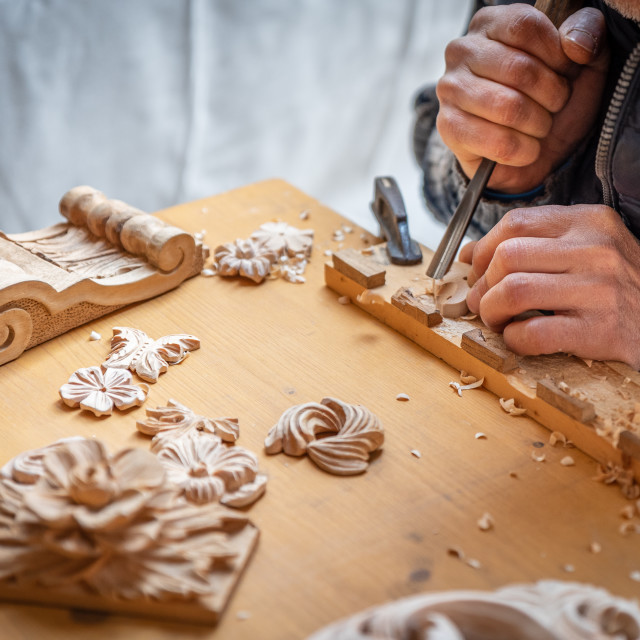 """""""The hands of a craftsman carve wooden decorations"""" stock image"""