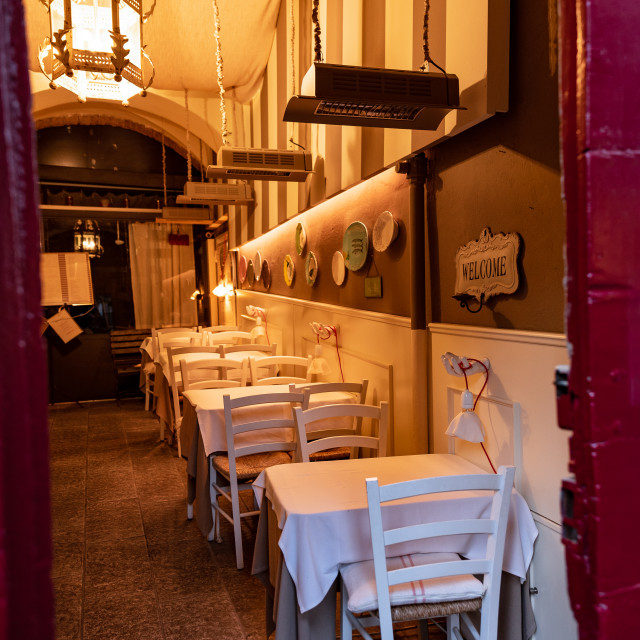 """""""Entrance to a historic restaurant with white tables and chairs"""" stock image"""