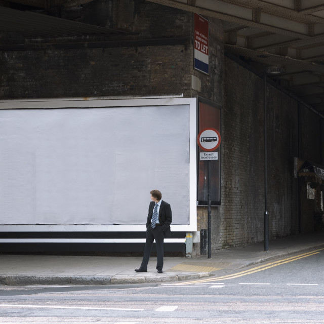 """A businessman looking at a blank billboard"" stock image"