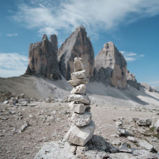 """Small tower of rocks in front of Tre Cime di Lavaredo"" stock image"