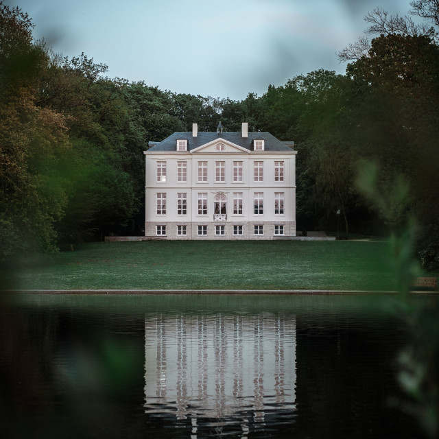 """""""Small castle with reflection in lake"""" stock image"""