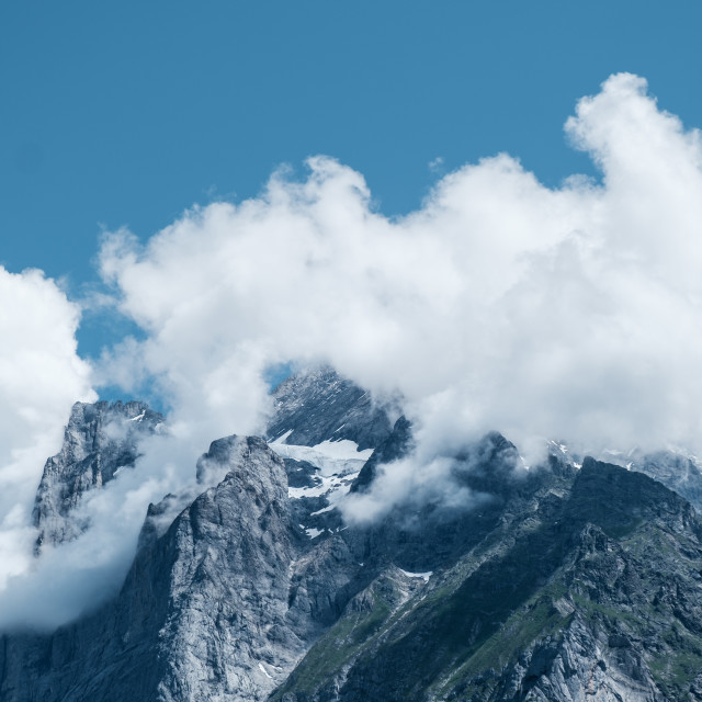 """""""Clouds over the mountain tops"""" stock image"""