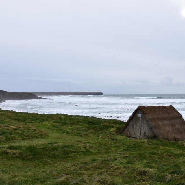 """""""A view of the seaweed hut at Freshwater West with Linney Head in the background."""" stock image"""