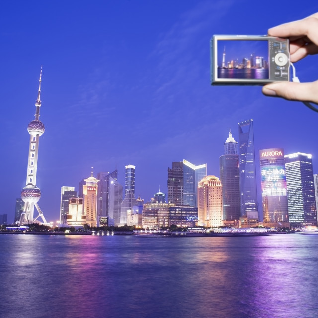 """""""Tourist photographing the Pudong skyline at dusk"""" stock image"""