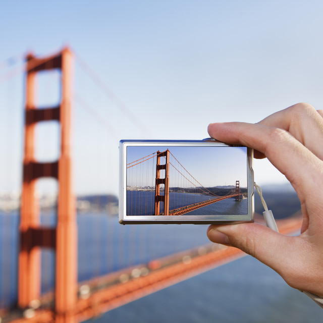 """""""Tourist photographing the Golden Gate Bridge with a digital came"""" stock image"""