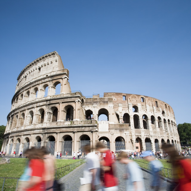 """""""Tourists walking past the Colosseum"""" stock image"""
